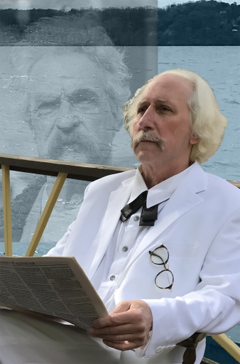 Picture shows Joe Baer portrating Samuel Clemens in his iconic white suit with a ghost image of Mark Twain in the background.